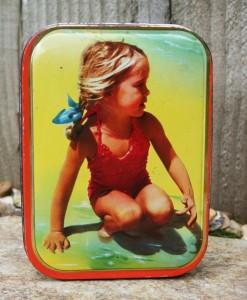 sharps-toffee-tin-girl-on-beach-1